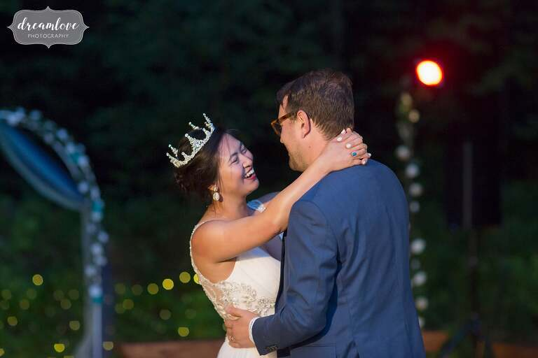 Romantic bride and groom dance under the stars during their intimate wedding in NH.