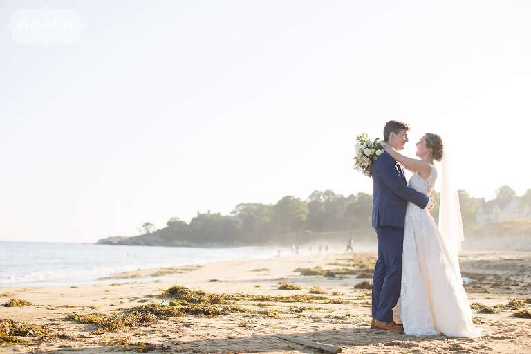 Bride and groom embrace on the Singing Beach for this North Shore wedding in Manchester-by-the-Sea, MA.