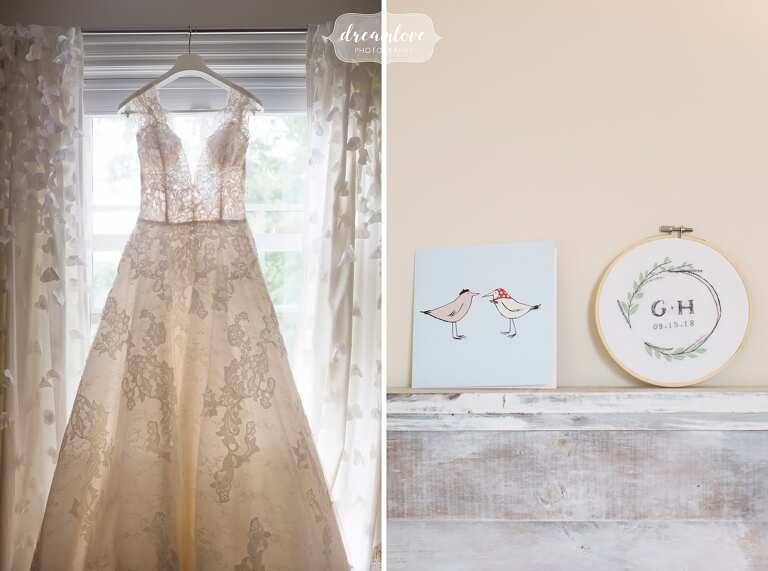 Pronovias lace dress hangs in bride's room before her North Shore wedding in Manchester-by-the-Sea, MA.
