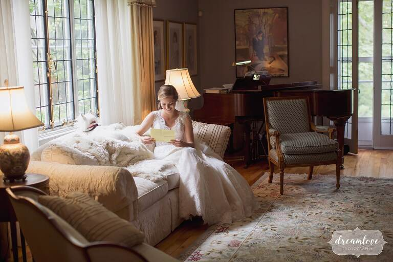 The bride reads the groom's letter in her before their North Shore wedding at home on Tuck's Point, MA.
