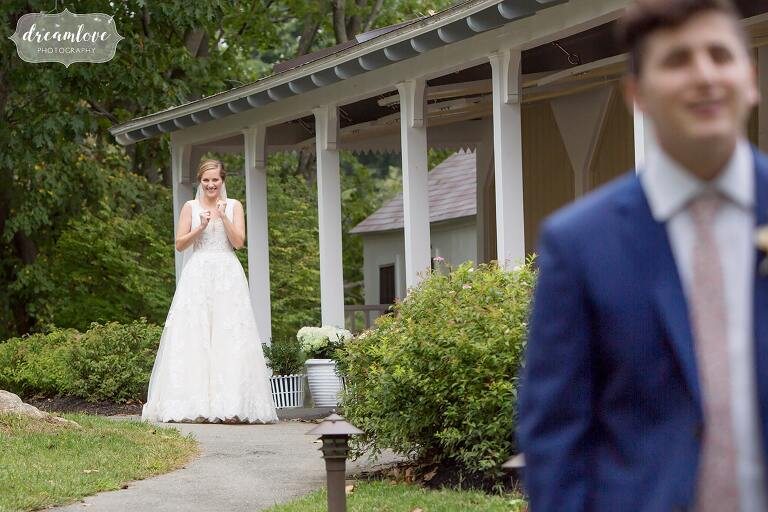 Emotional first look between bride and groom at Tuck's Point pavilion in Manchester by the Sea, MA wedding.