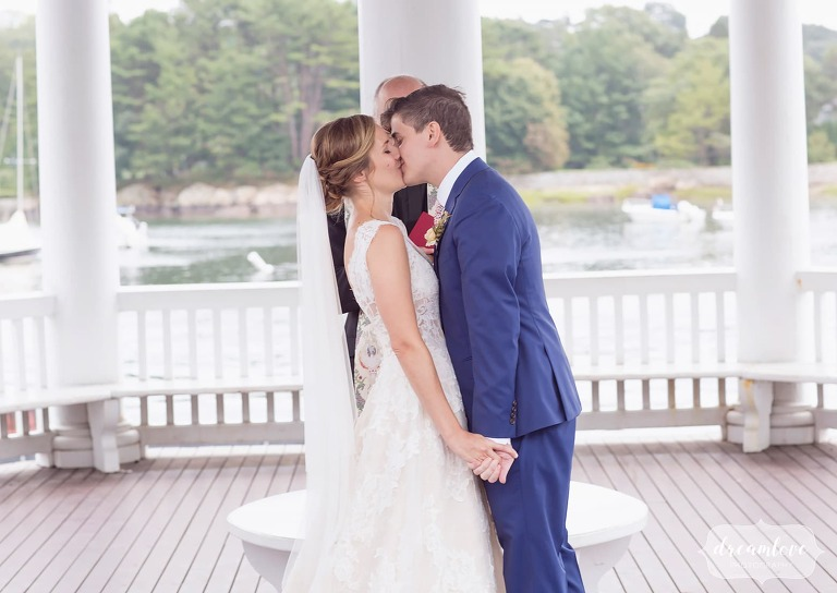 The bride and groom kiss at the end of their small ceremony on Tuck's Point.