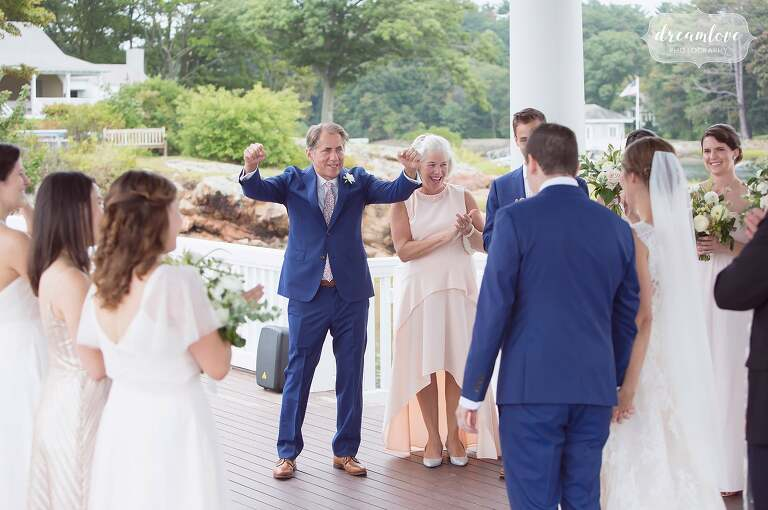 The father of the bride is super excited after the wedding in Manchester by the Sea, MA.