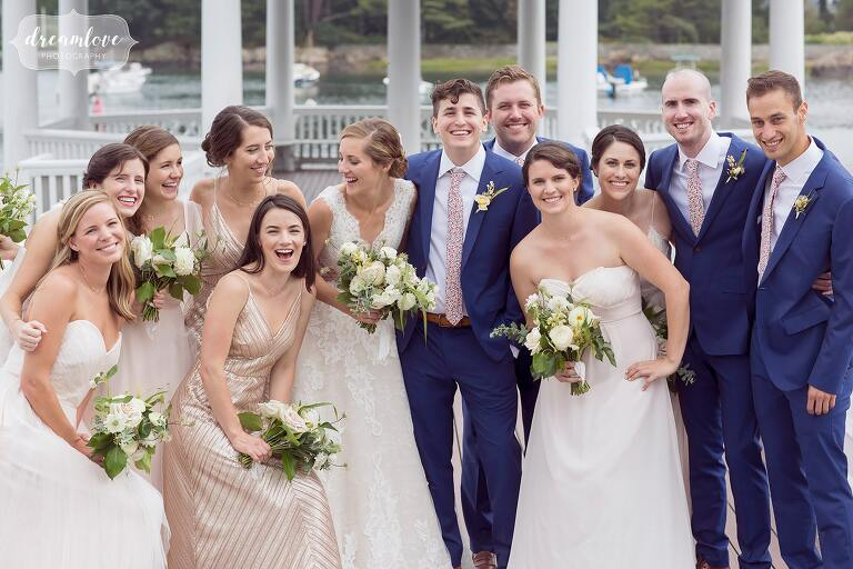 Wedding party laughing on Tuck's Point, MA.