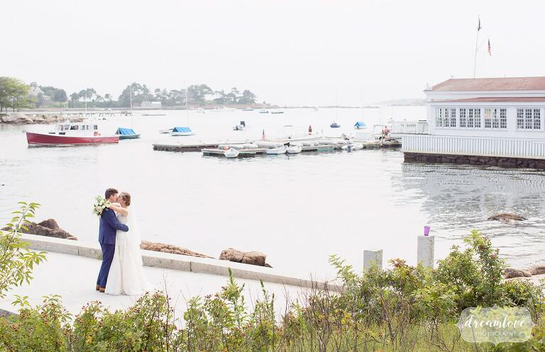 Bride and groom on the dock near the yacht club on Tuck's Point.