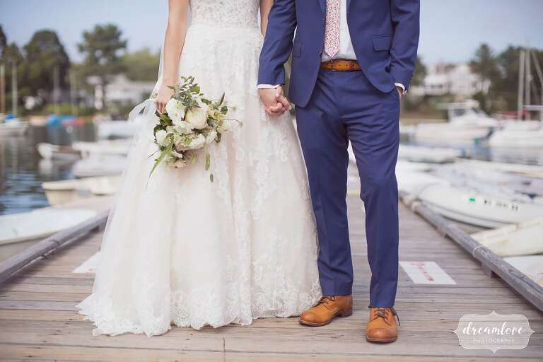 Bride and groom hold hands for this North Shore MA wedding.