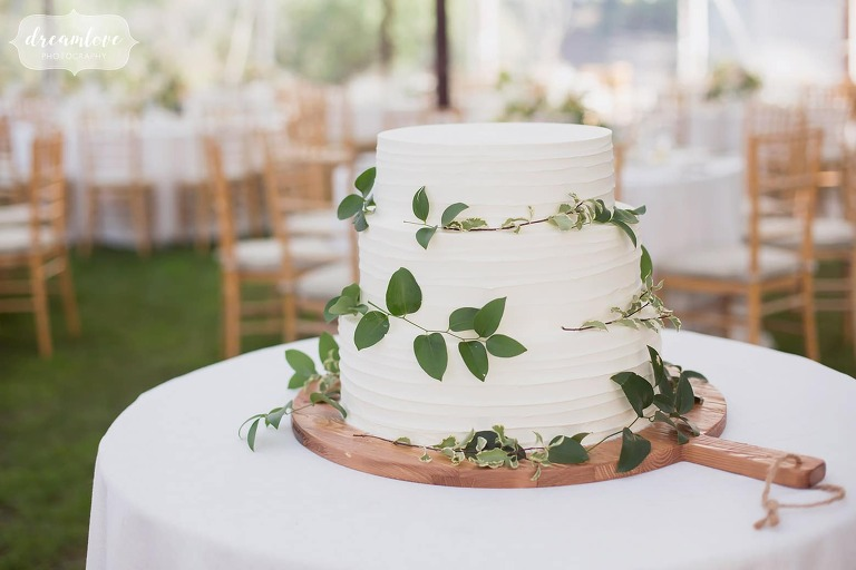 Simple wedding cake with greenery at this Singing Beach Club wedding on the North Shore of MA.
