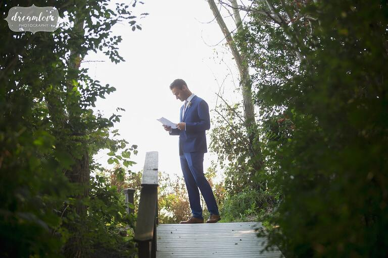 Best man works on his speech at the Singing Beach Club wedding venue.