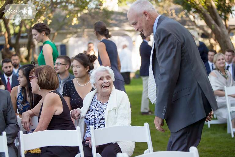 Grandma talks to a wedding guest at the Singing Beach Club wedding on the North Shore.