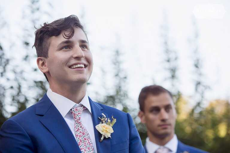Groom sees bride walking down the aisle for this North Shore wedding in MA.