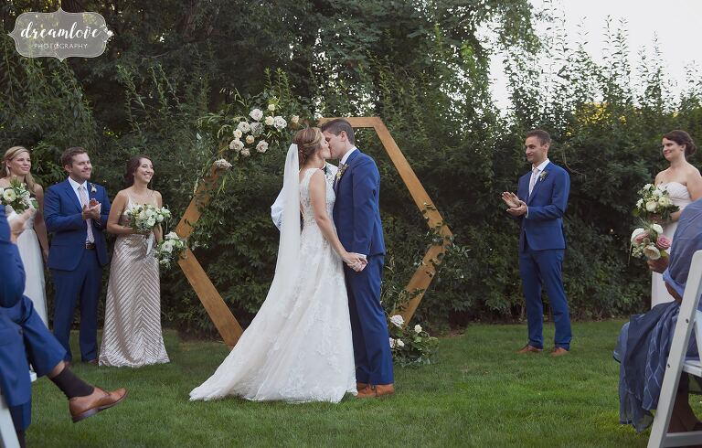 Modern floral wedding ceremony on the North Shore of MA.