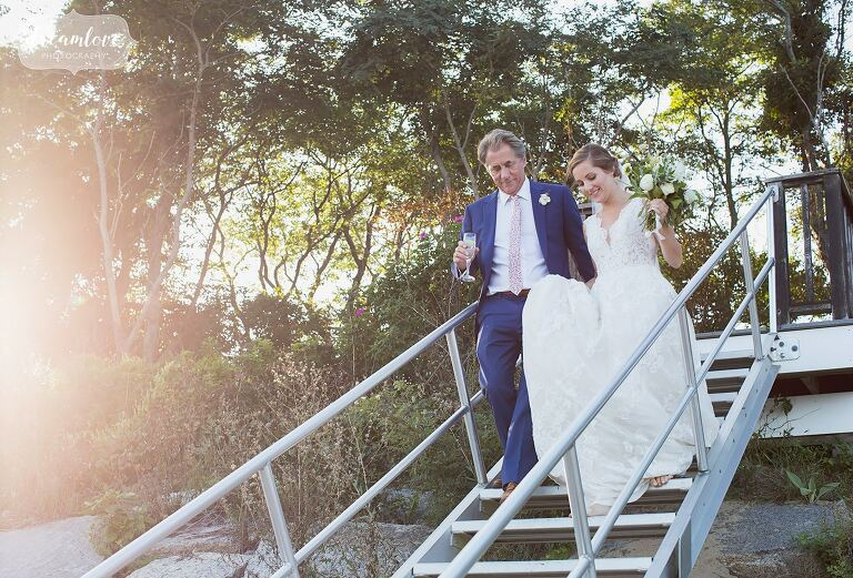 Bride and her father walk down stairs to the Singing Beach.