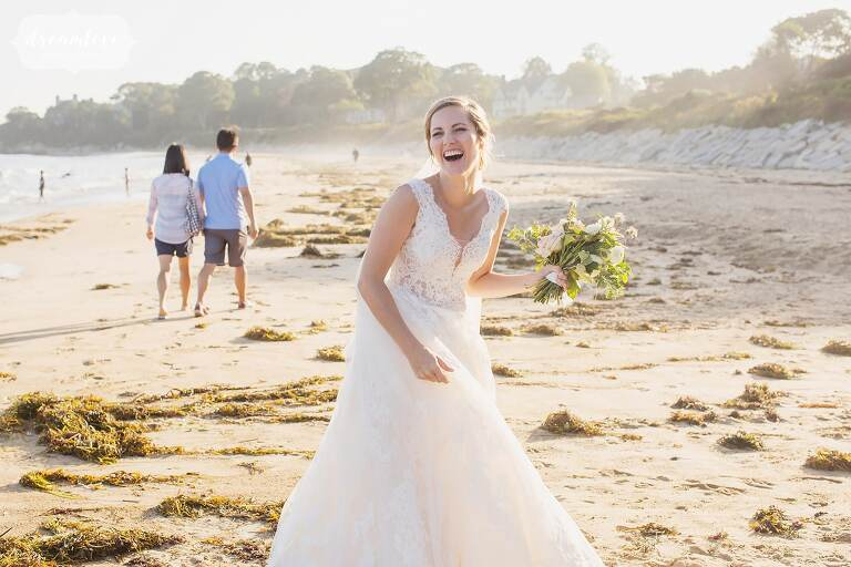 Bride laughing on the Singing Beach on the North Shore of Boston.