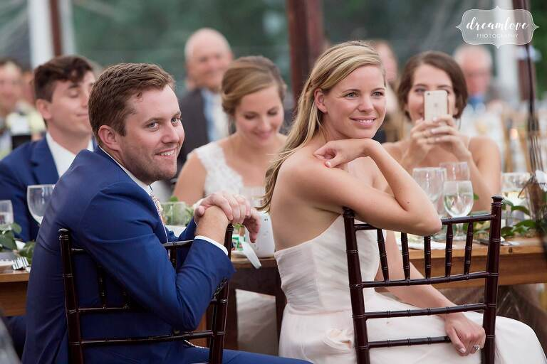 Family watches toasts at this Singing Beach Club wedding.