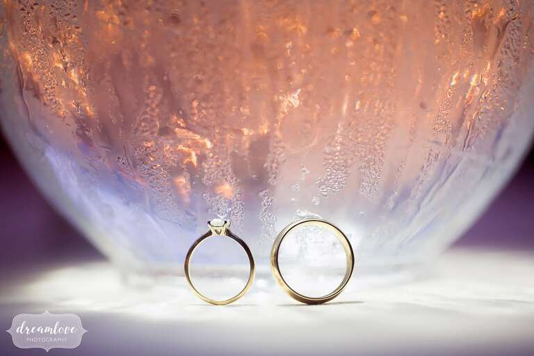 Fine art wedding photo of the rings on water droplets.
