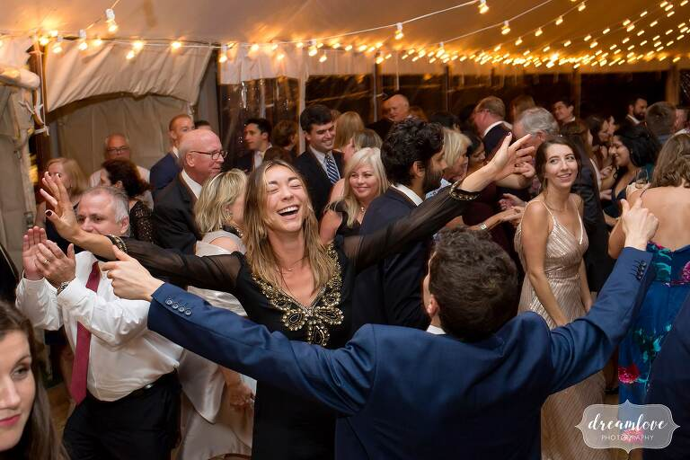 Guests dance at Singing Beach Club wedding on North Shore.