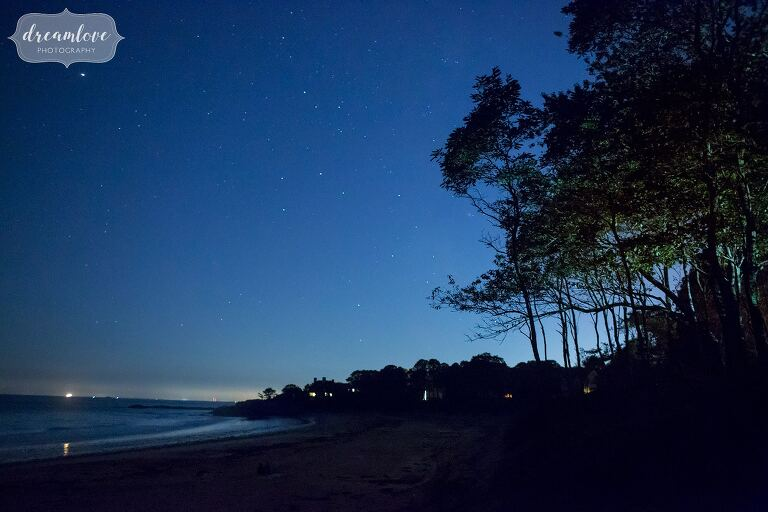 Stars in blue light over the ocean after this North Shore MA wedding on Singing Beach.
