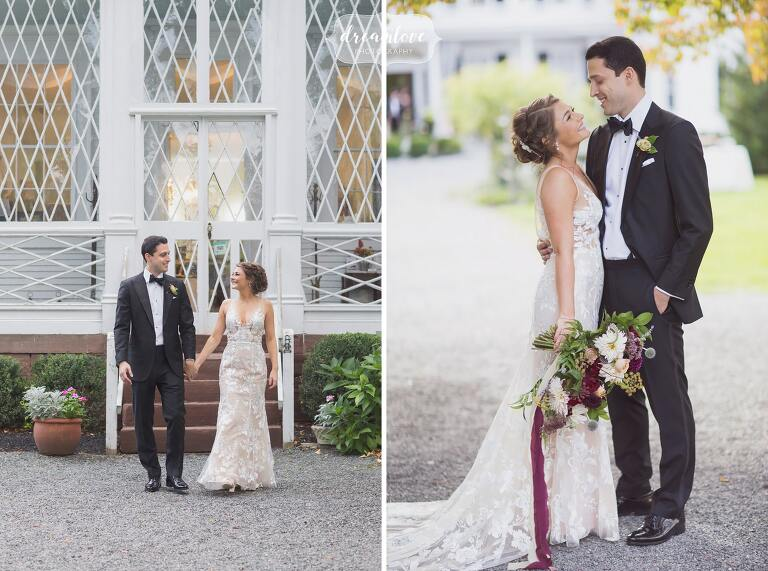 The bride and groom stand outside of the sun room before their Linden Place wedding in RI.