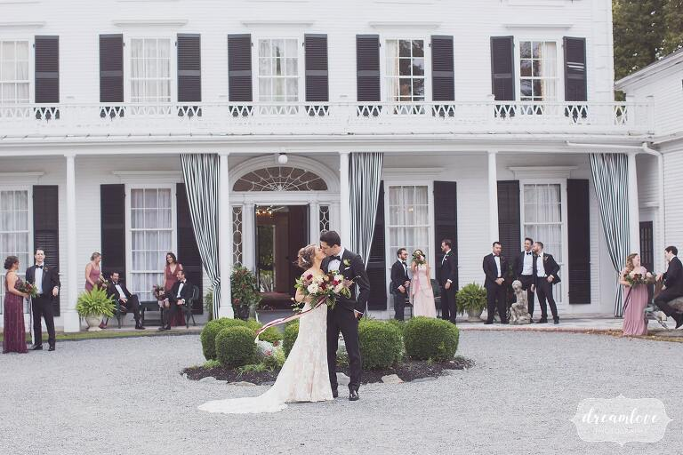 The wedding party poses behind the Linden Place museum, a historic wedding venue in RI.
