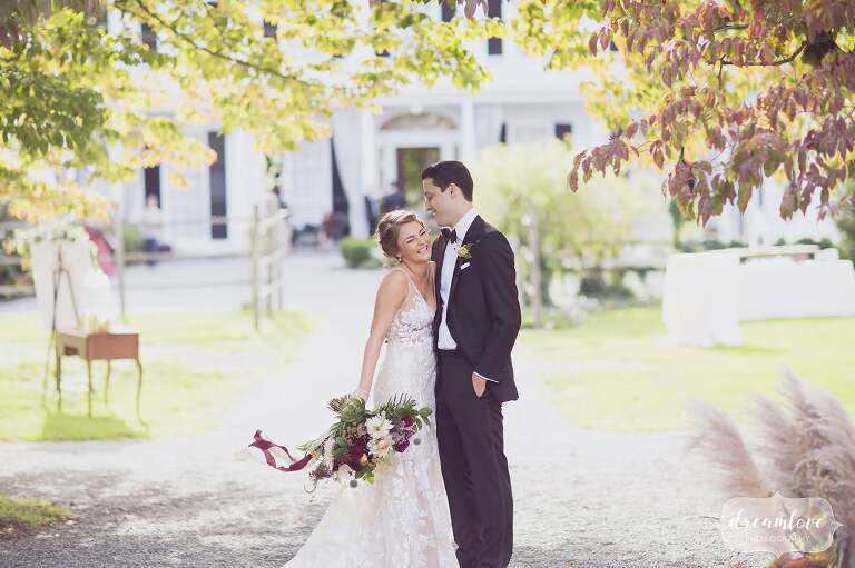 Ethereal portrait of the bride and the groom at the Linden Place mansion in Bristol.