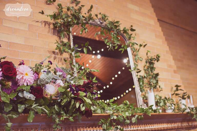 Romantic wedding floral garland over fireplace at Linden Place mansion in RI.