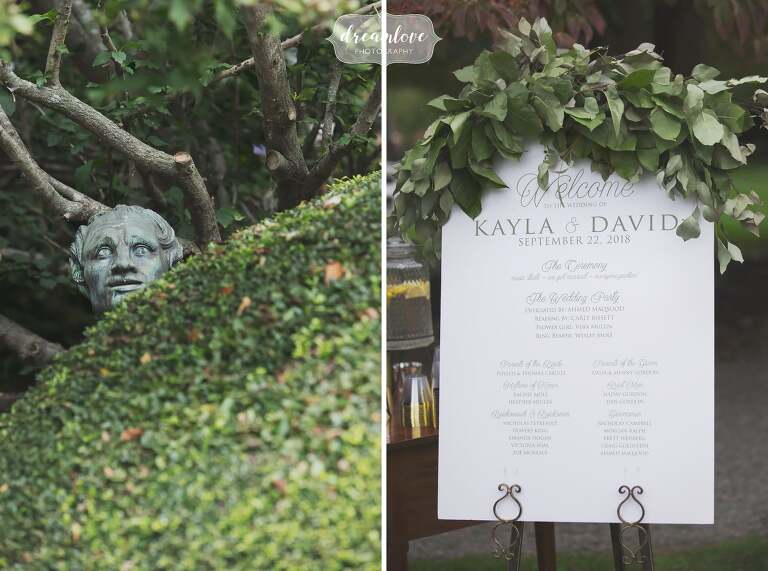 A funny wedding photo of a statue peeking over a bush at the Linden Place.