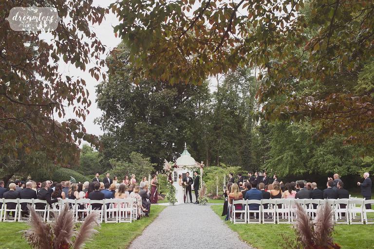 Linden place wedding ceremony in sculpture garden.