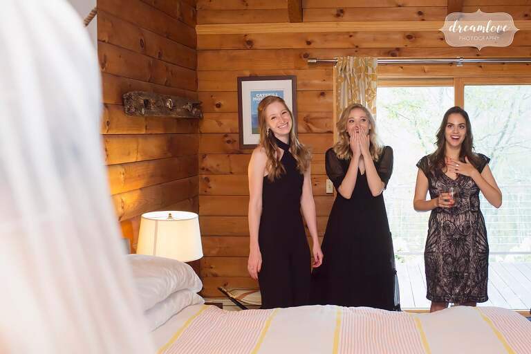 The bridesmaids see the bride in her dress at this Catskills NY wedding.