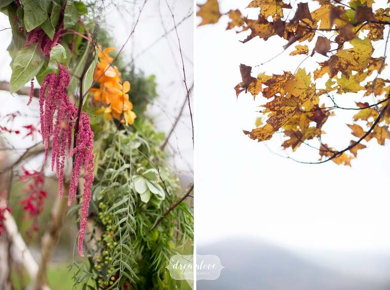 Flowers are draped on this birch wood arbor for this Catskills backyard wedding in October.