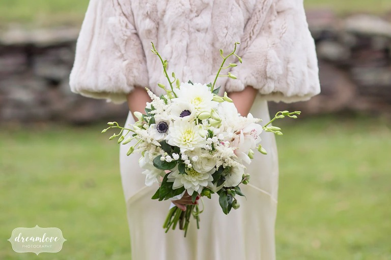 The bride wore a beige fur stole for this outdoor wedding in the Catskills in October.