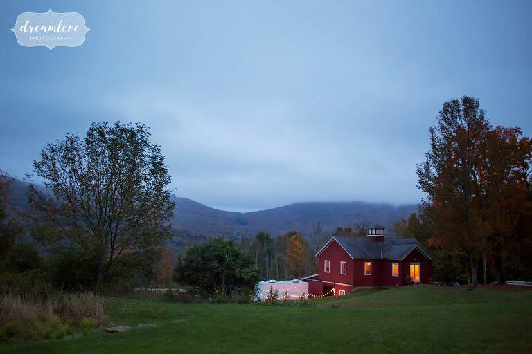 Beautiful red house in the hills among fall foliage for this Catskills NY wedding.