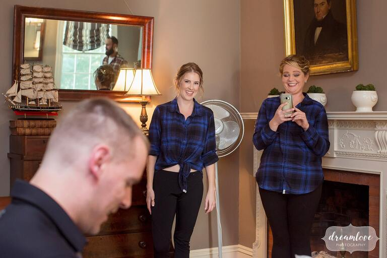The bridesmaids in blue plaid shirts deliver the groom's gift before this fall wedding at Glen Magna Farms.