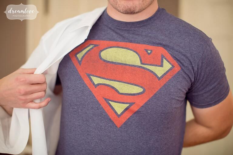 The groom wears a superman undershirt before his Glen Magna Farms wedding.