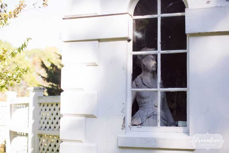 A sculpture looks out a window at the Glen Magna Farms venue.