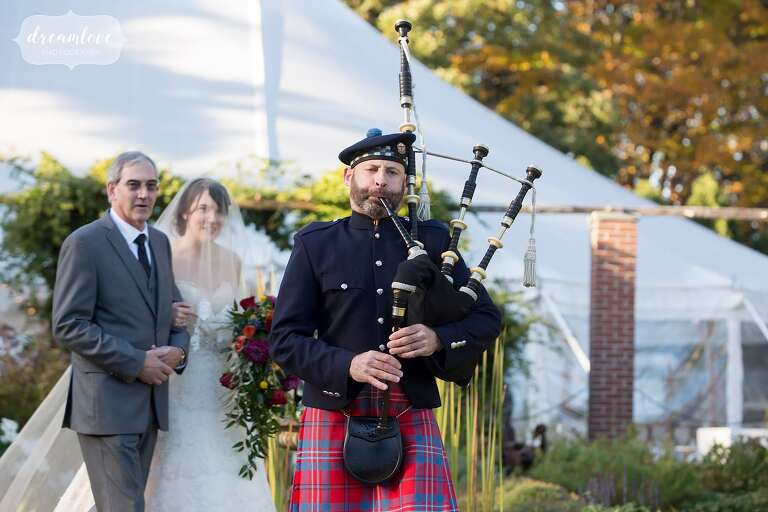Scottish bagpiper leads the outdoor ceremony at the Glen Magna Farms wedding.
