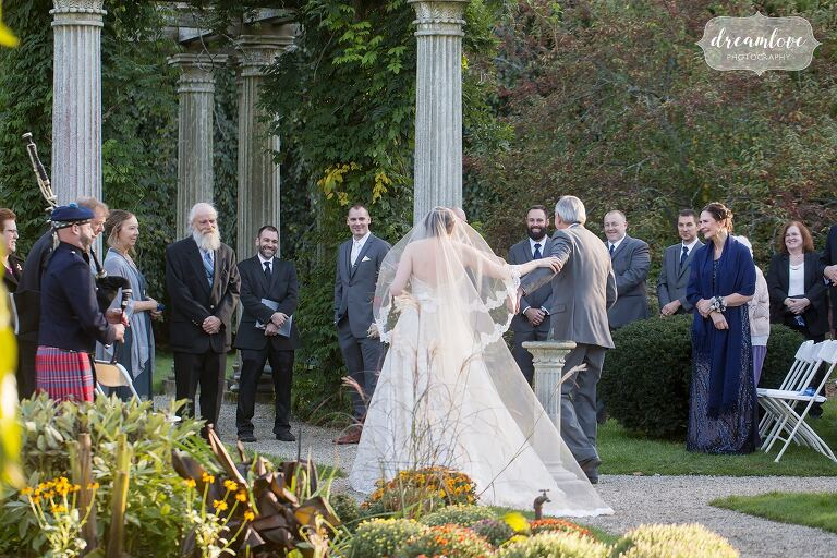 The father and the bride walk into the ceremony at the Glen Magna Farms.