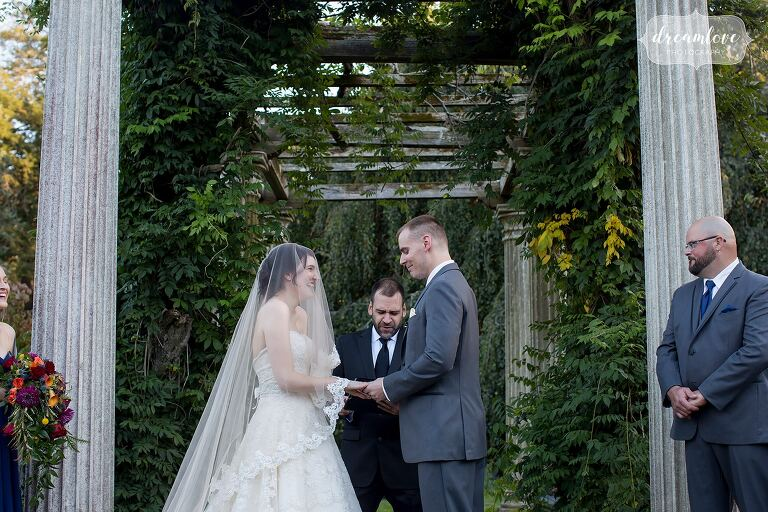Bride and groom exchange vows at the Glen Magna Farms venue.