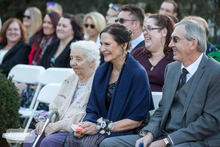 The mother of the bride watches outdoor ceremony at Glen Magna.