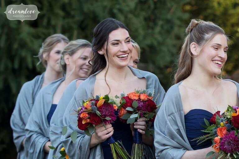Bridesmaids watch ceremony at the Glen Magna Farms venue in MA.
