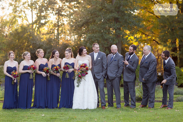 The wedding party in navy and grey on the lawn at Glen Magna Farms.