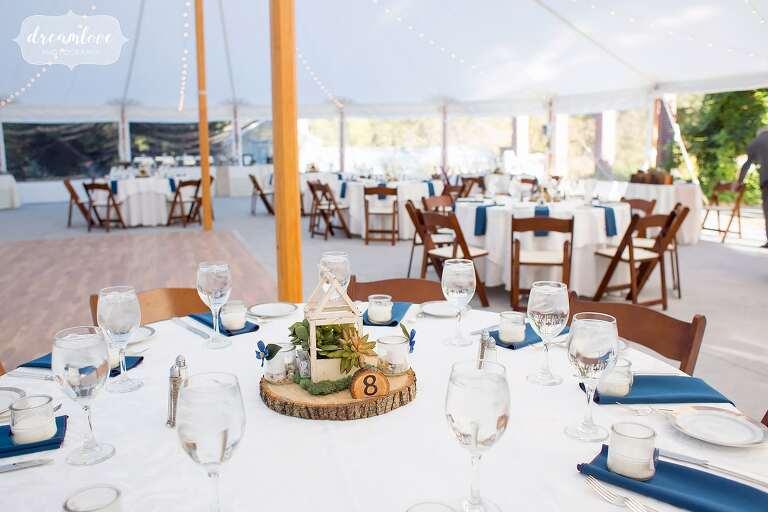 Rustic wedding decor at this tented reception at Glen Magna Farms.
