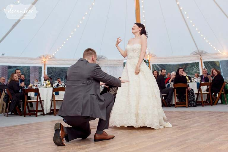 The bride and groom play air guitar during this heavy metal first dance at Glen Magna Farms.