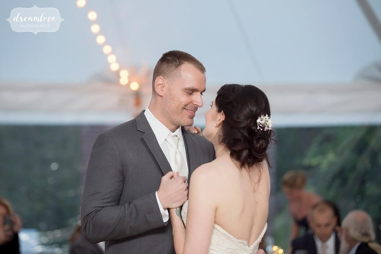 The bride and groom dance under the tent for this Glen Magna Farms.