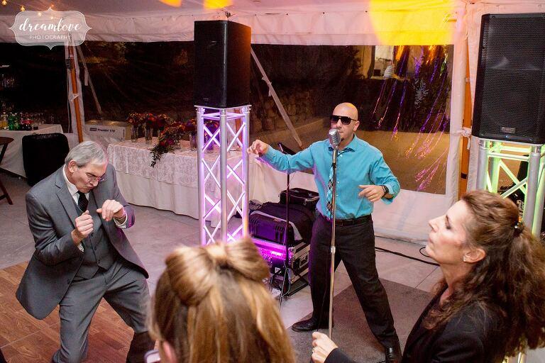 The DJ does a lip sync at this Glen Magna Farms October wedding.