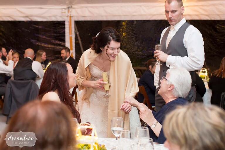 The bride talks to her grandmother at this North Shore wedding at Glen Magna Farms.