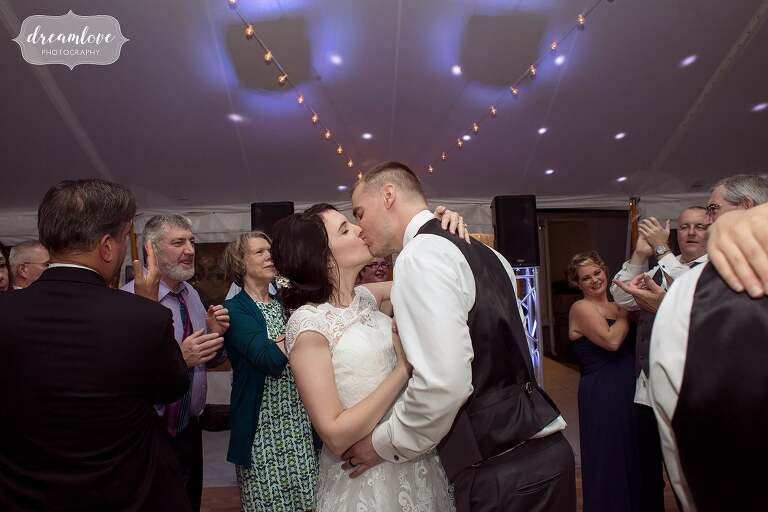 The bride and groom kiss on the dance floor at the Glen Magna Farms.