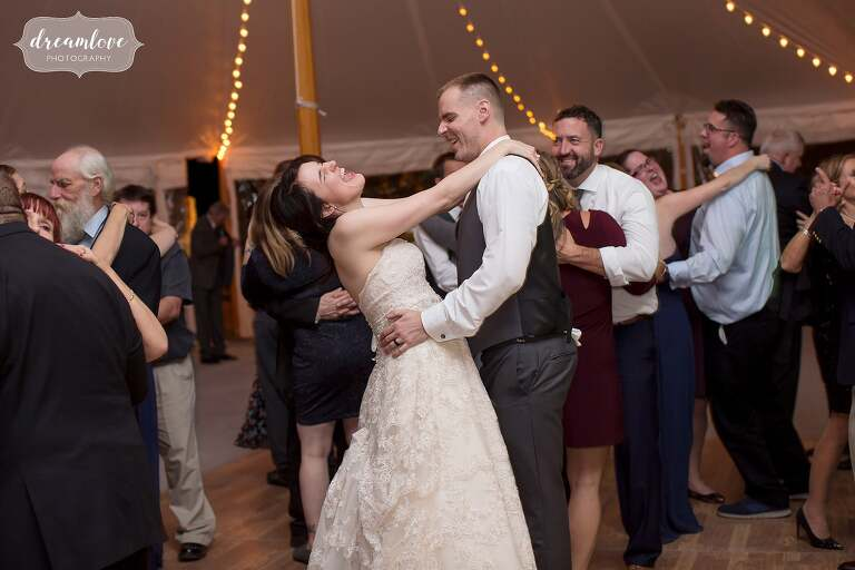 The bride and groom have a wild dance at the Glen Magna Farms reception.