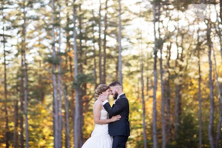 The bride and groom at their Windsor Mansion wedding with pine trees.