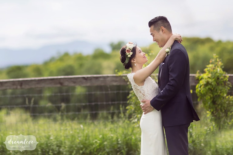 Bride wraps arms around groom at Hudson Valley Barn wedding in Ghent.