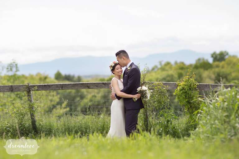 Bride wearing flower crown with Hudson Valley mountains backdrop.